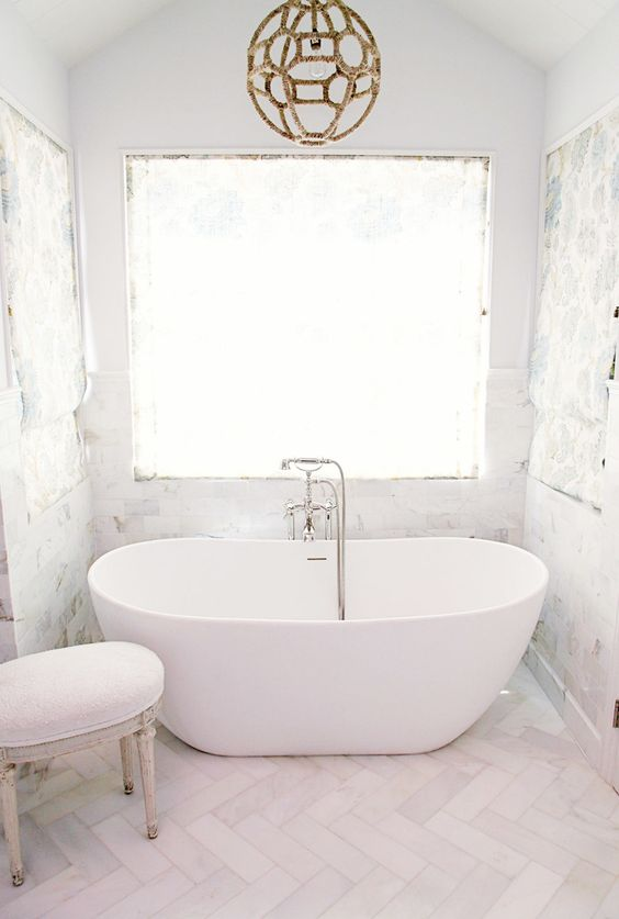 Natural light, chevron marble and a freestanding tub. Yes please.