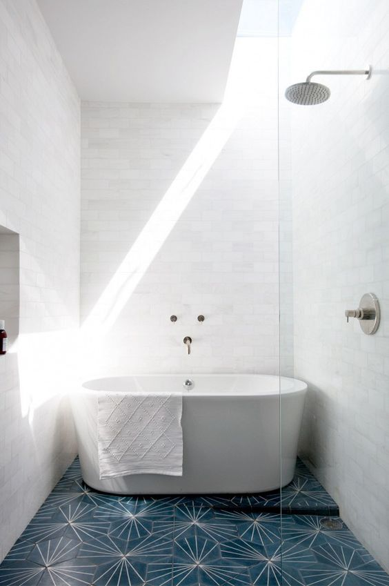 Marble subway walls flooded with natural light and a delicious deep soaker tub.