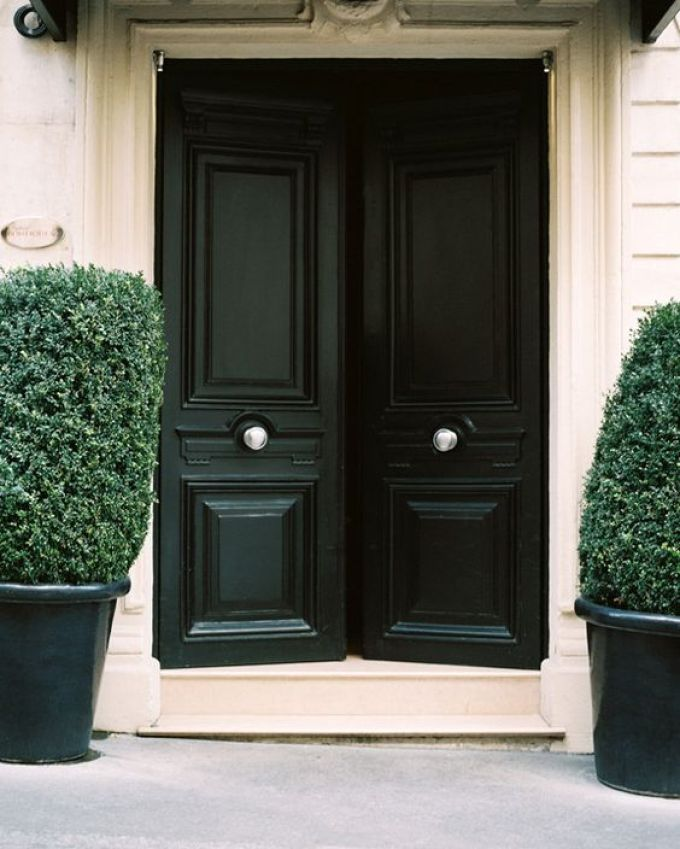 Double black door with centered knobs
